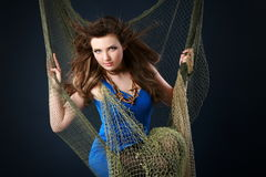 Beautiful girl in fishnet Royalty Free Stock Photos