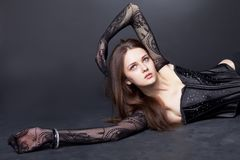 Beautiful girl with fishnet tights on hand Stock Photography