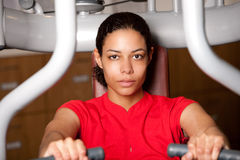 Beautiful girl on fitness machine Stock Photography