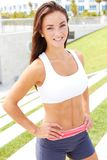 Beautiful girl in fitness wear on steps Stock Image