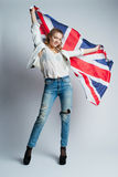 Beautiful girl with flag of Britain Stock Images