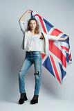 Beautiful girl with flag of Britain Royalty Free Stock Photo