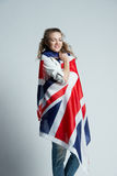 Beautiful girl with flag of Britain Royalty Free Stock Photography