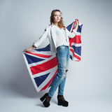 Beautiful girl with flag of Britain Stock Photo