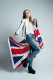 Beautiful girl with flag of Britain Royalty Free Stock Image