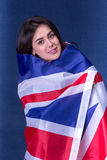 Beautiful girl with the flag of Britain Stock Photography