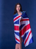 Beautiful girl with the flag of Britain Royalty Free Stock Images