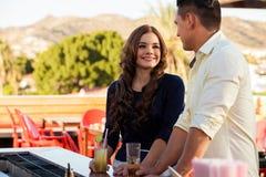 Beautiful girl flirting at a bar Royalty Free Stock Image