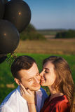 Beautiful girl flirting with her handsome boyfriend Stock Images