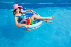 Beautiful girl in a floating jn the swimming circle in the pool Royalty Free Stock Images