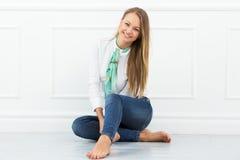 Beautiful girl on the floor Stock Image