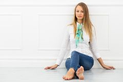 Beautiful girl on the floor Royalty Free Stock Photography