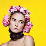 Beautiful girl with floral headphones Stock Photography