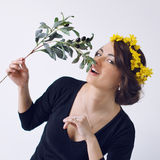 Beautiful girl with floral wreath and olive branch Royalty Free Stock Photos