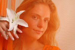 Beautiful girl with flower Royalty Free Stock Images