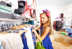 Beautiful girl with flower accessory in shop Royalty Free Stock Images