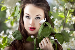 Beautiful girl on flower background with flowers in hair, glamou Stock Photo
