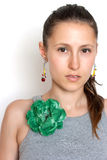 Beautiful girl with a flower brooch Royalty Free Stock Images