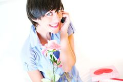 Beautiful girl with flower on cell Stock Images