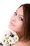 Beautiful  girl with flower. Facial massage. Royalty Free Stock Photo