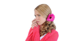 Beautiful girl with a flower in her hair. Stock Photos