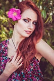 Beautiful girl with flower in her long hair Royalty Free Stock Photos