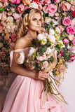 Beautiful girl at the flower interior Royalty Free Stock Photography