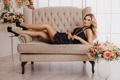 Beautiful girl at the flower interior Royalty Free Stock Photos