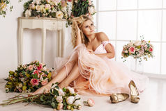 Beautiful girl at the flower interior Royalty Free Stock Images