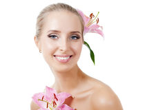 Beautiful girl with a flower lily Stock Photo