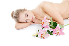 Beautiful girl with a flower lily Stock Images
