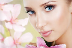 Beautiful girl with a flower lily Stock Photos