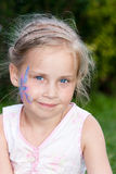 Beautiful girl with flower paining on her face Stock Photo