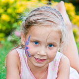 Beautiful girl with flower paining on her face Stock Image