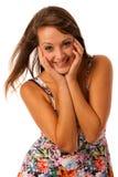 Beautiful girl in flower patern short summer dress posing against white Stock Photography