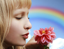 Beautiful girl with flower on rainbow background Royalty Free Stock Images