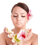 Beautiful girl with  flower in spa. Royalty Free Stock Image