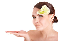 Beautiful girl with  flower in spa. Royalty Free Stock Images