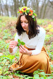 Beautiful girl with flower wreath on her head in the autumn nature Royalty Free Stock Image