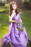 Beautiful girl with flower wreath Stock Photos