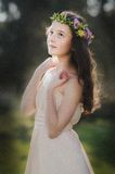 Beautiful girl with flower wreath Royalty Free Stock Images