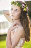 Beautiful girl with flower wreath Stock Image