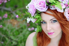 Beautiful girl in a flowered garden peach Royalty Free Stock Image