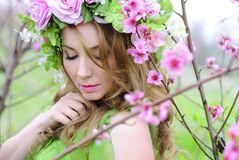 Beautiful girl in a flowered garden peach Stock Images