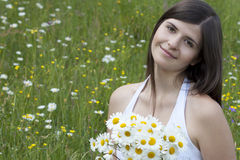 Beautiful girl with flowers Stock Photography