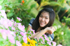 Beautiful girl with flowers. At Bangkok garden Thailand Royalty Free Stock Photo