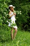 Beautiful girl and flowers. Beautiful girl in white and flowers Royalty Free Stock Photography
