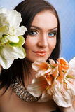 Beautiful girl with flowers. Stock Photography