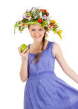 Beautiful girl with flowers and apple Stock Photography
