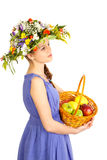 Beautiful girl with flowers and apples Stock Image